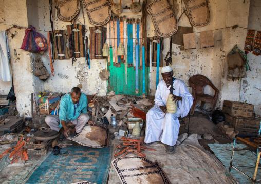 Sudanese men working on leather in the market, Kassala State, Kassala, Sudan