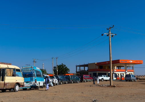 Sudanese people in their cars queue on line at a gas station during the fuel shortages, Red Sea State, Suakin, Sudan