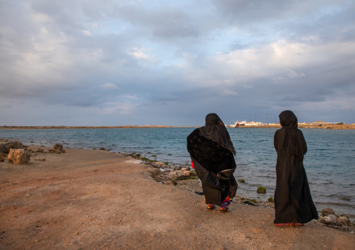 Rashaida tribe women looking at the sea, Red Sea State, Suakin, Sudan