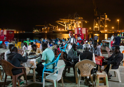 Sudanese men playing cards and dominos on the corniche, Red Sea State, Suakin, Sudan