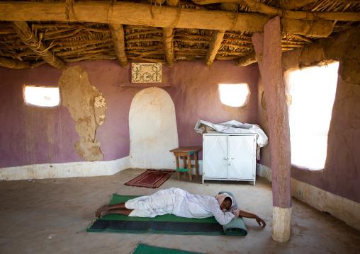 Sudanese man sleeping inside a small mosque, Kassala State, Kassala, Sudan