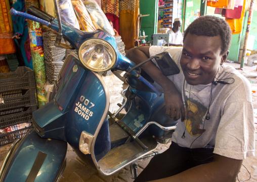 Sudan, Khartoum State, Omdurman, man with his scooter