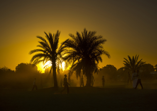 Sudan, Nubia, Tumbus, kids playing football in the desert at sunset