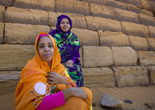 Sudan, Kush, Meroe, sudanese women in front of the pyramids and tombs in royal cemetery