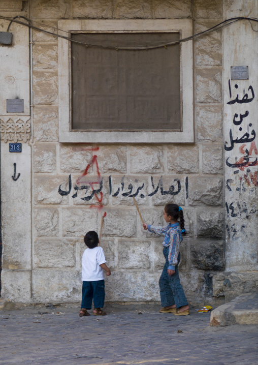 Kid Learning To Read Arabic In The Street, Aleppo, Aleppo Governorate, Syria
