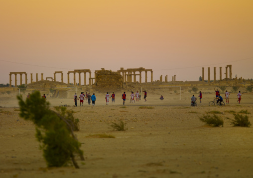 Men Playing Football In The Ancient Roman City, Palmyra, Syrian Desert, Syria