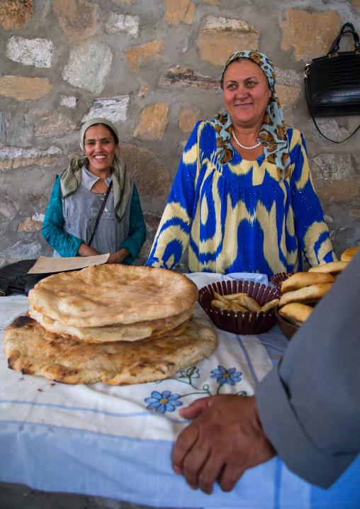 Tajik women selling bread in the market border with Afghanistan, Central Asia, Ishkashim, Tajikistan