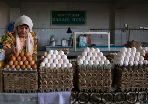 Old tajik woman selling eggs in a local market, Gorno-Badakhshan autonomous region, Khorog, Tajikistan