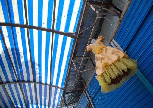 Dress for children hanging on the roof of a shop in a local market, Gorno-Badakhshan autonomous region, Khorog, Tajikistan