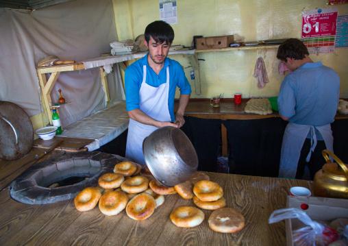 Tajik men making bread in a local bakery, Gorno-Badakhshan autonomous region, Khorog, Tajikistan