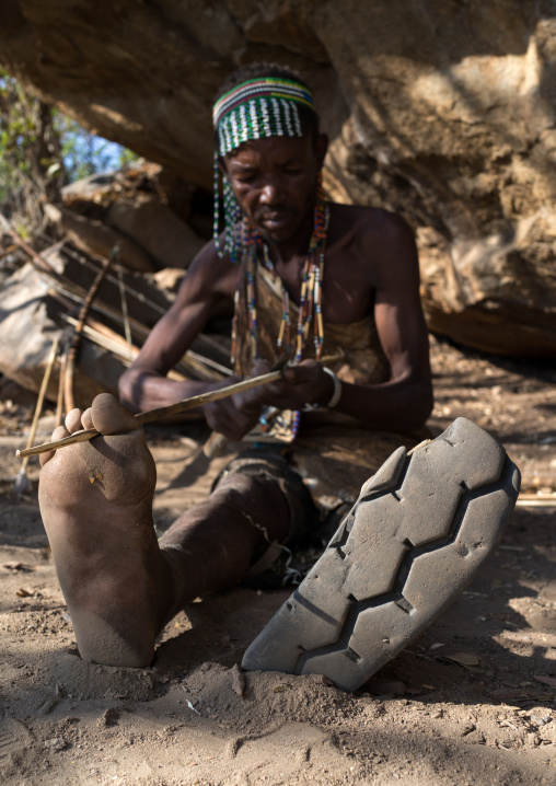 Tanzania, Serengeti Plateau, Lake Eyasi, hadzabe tribe man shoes made from a car tyre