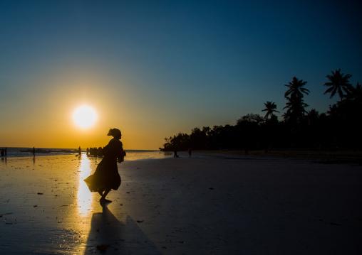 Girl Running On Beach During Sunset