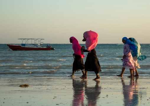 Tanzania, Zanzibar, Kizimkazi, young muslim girls in school uniform on beach