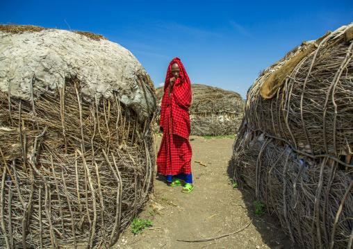 Tanzania, Ashura region, Ngorongoro Conservation Area, maasai woman outside her home
