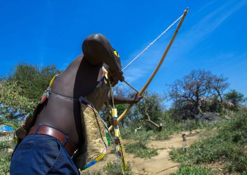 Tanzania, Serengeti Plateau, Lake Eyasi, hadzabe man with bow and arrow