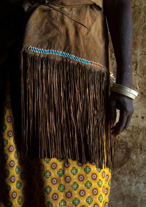 Tanzania, Serengeti Plateau, Lake Eyasi, datoga tribe woman wearing a leather dress