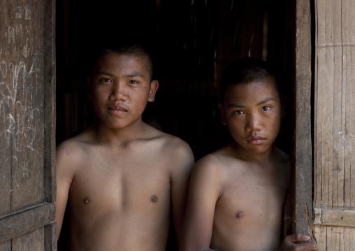 Twins boys called ja tor and ja lae, Black lahu twins, Thailand