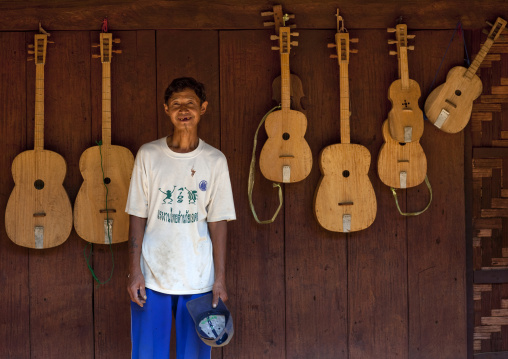 Karen man selling guitars, Nam peang din village, Thailand