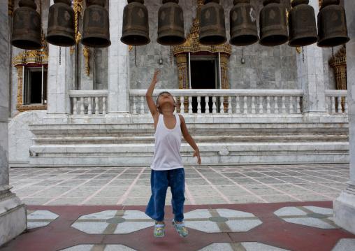 Ringing bells in buddhist temple, Bangkok, Thailand