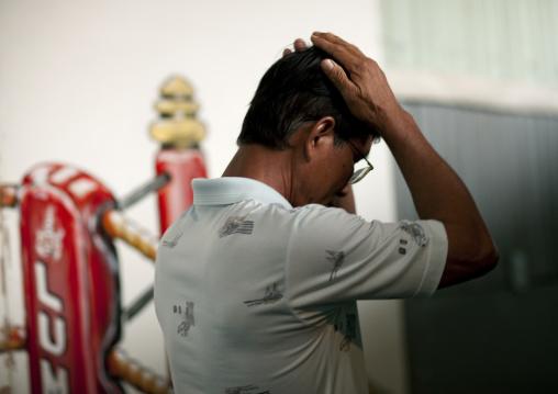 Praying for his son, Muay thai boxing, Bangkok, Thailand