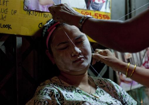 Mung-ming ancient chinese style hair removal at chinatown, Bangkok, Thailand