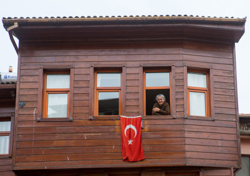 Smiling woman in her old wooden style house near the Bosphorus sea, Marmara Region, istanbul, Turkey