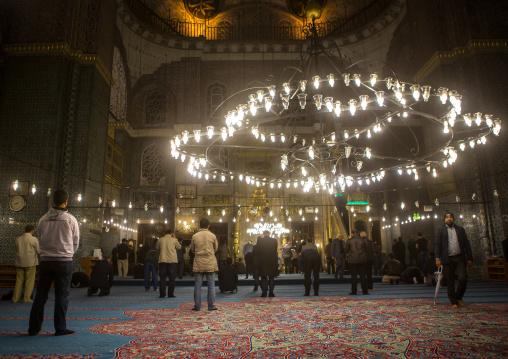 Muslim men praying inside new mosque Yeni Camii, Marmara Region, istanbul, Turkey