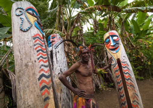 Small Nambas tribesman in front of the slit gong drums, Malekula island, Gortiengser, Vanuatu