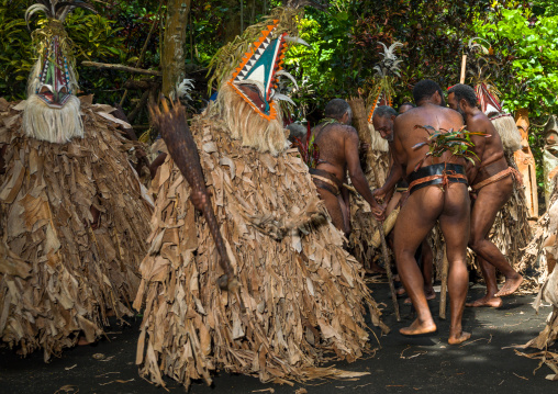 Tribesmen dressed in colorful masks and costumes made from the leaves of banana trees performing a Rom dance, Ambrym island, Fanla, Vanuatu