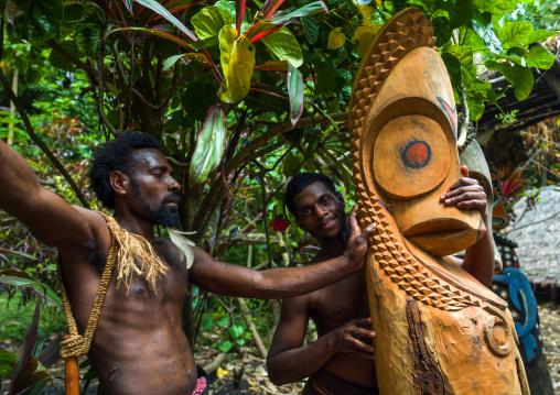 Tribesmen in front of a slit gong drum, Ambrym island, Fanla, Vanuatu