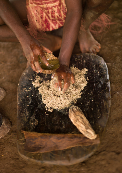Woman preparing and squeezing kava to drink at a traditional ceremony, Sanma Province, Espiritu Santo, Vanuatu