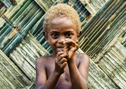 Portrait of a boy with blonde hair, Malampa province, Malekula island, Vanuatu
