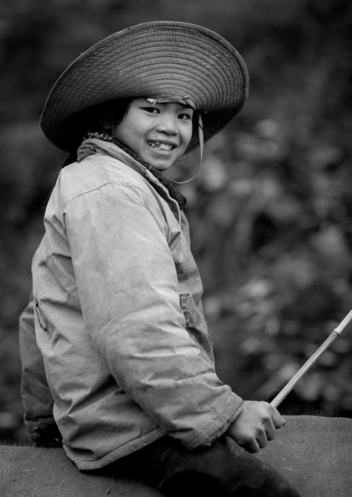 Smiling boy wearing a big hat, Sapa, Vietnam