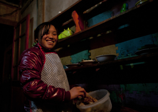 Woman smiling while cooking, Sapa, Vietnam