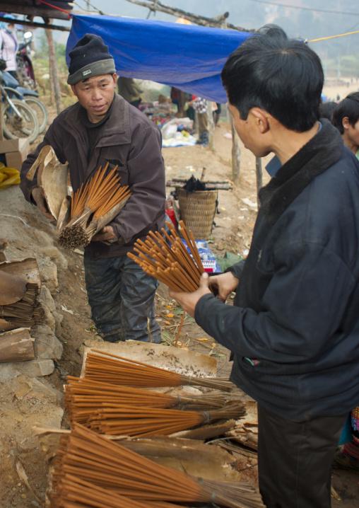 Men selling incense sticks, Sapa, Vietnam