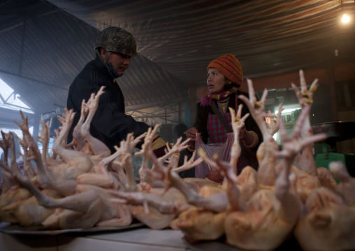 Woman buying chicken at the meat market, Sapa, Vietnam