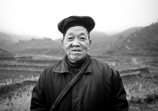 Old black hmong woman in front of paddy fields, Sapa, Vietnam
