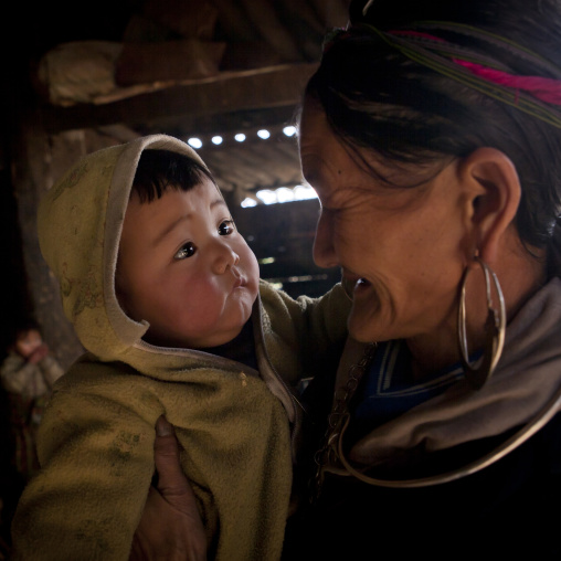 Black hmong grandmother with her grandson in the arms, Sapa, Vietnam