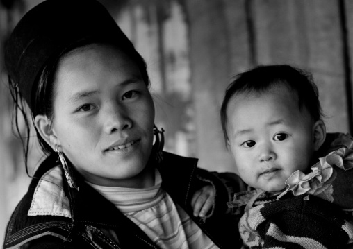 Black hmong mother and baby in traditional clothes, Sapa, Vietnam