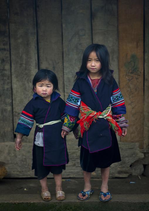 Young black hmong girls in traditional dress, Sapa, Vietnam