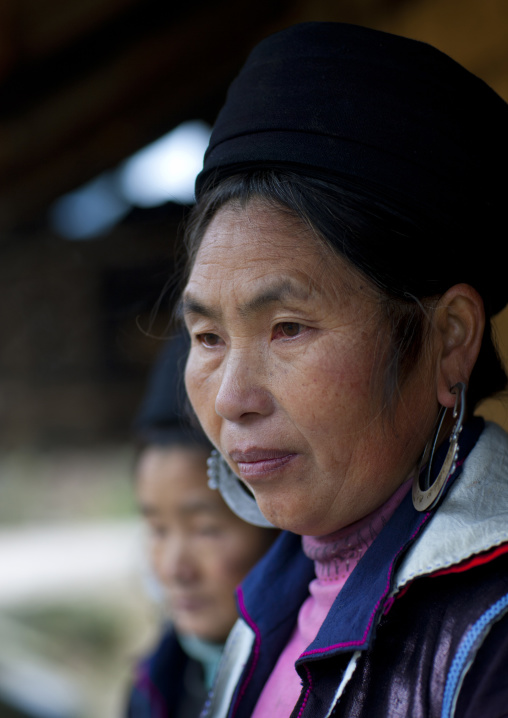 Black hmong woman with traditional hat and earrings, Sapa, Vietnam