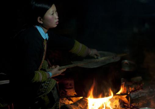 Red dzao girl cooking, Sapa, Vietnam