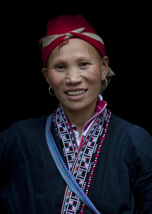 Red dzao woman with a red headscarf, Sapa, Vietnam