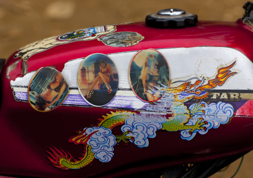 Motorike decorated with a dragon and bimbo pictures, Sapa, Vietnam