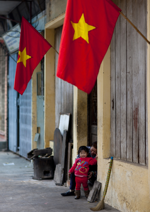 Mother and her young daughter smiling for tet day, Hanoi, Vietnam