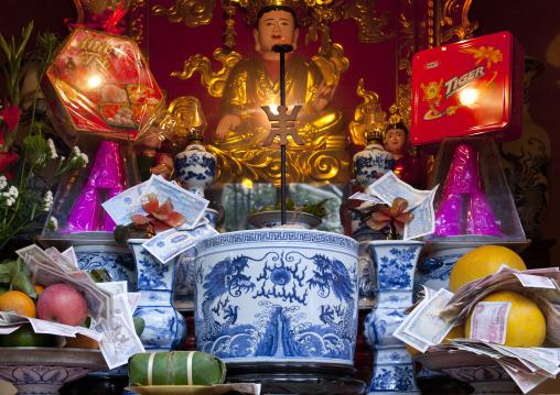 Offerings in a bhuddhist temple, Hanoi, Vietnam