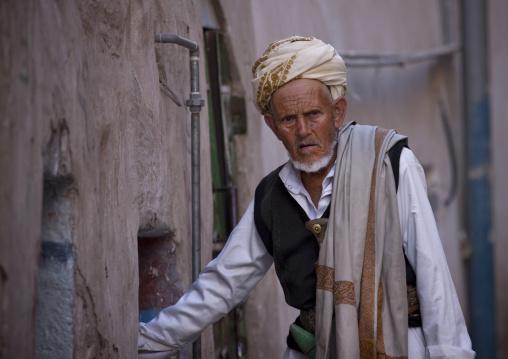 Old Yemeni Man Wearing Traditional Clothes And A Jambiya In A Street Of Sanaa, Yemen