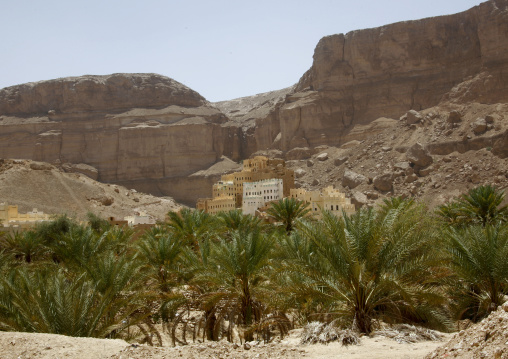 Traditional Buildings Overlooking The Palm Trees In Hadramaut, Yemen