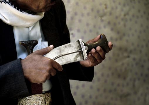 Man Checking The Pommel Of A Jambiya, Yemen