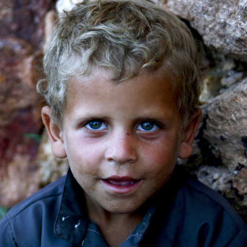 Blue Eyed Boy With Blond Hair Looking Up And Smiling In Shahara, Yemen